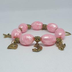 Rosa armband med berlock